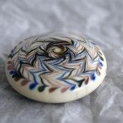 bouclier-perle-de-verre-au-chalumeau